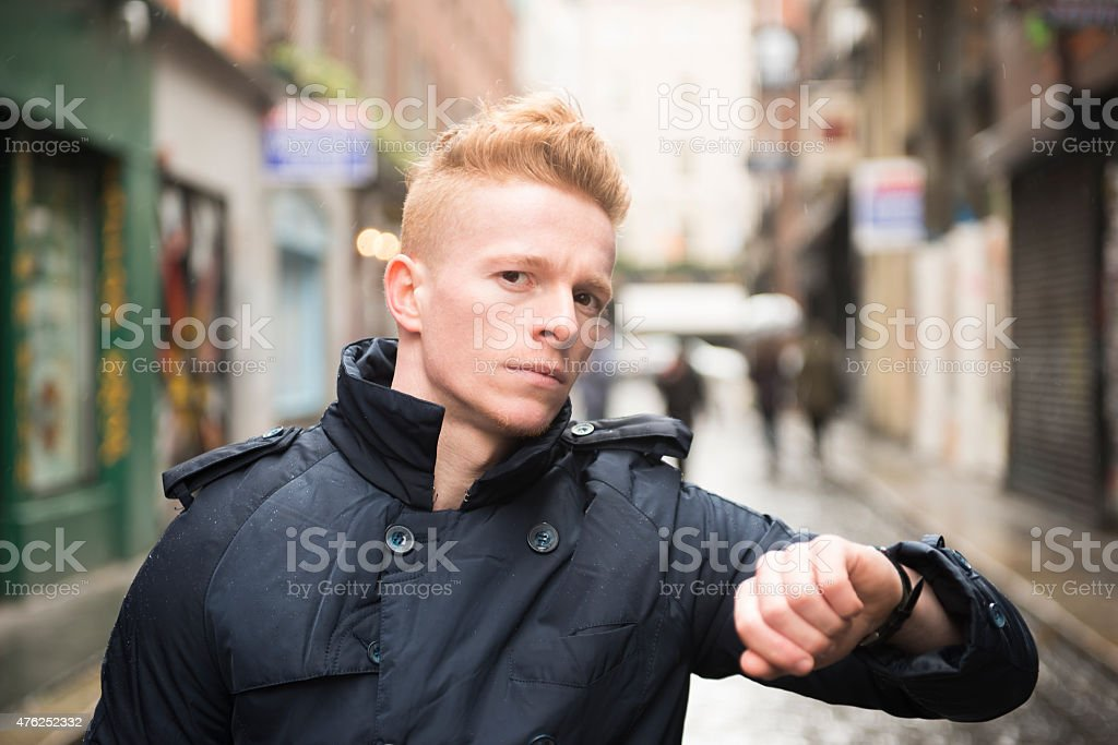 Angry man checking the time stock photo