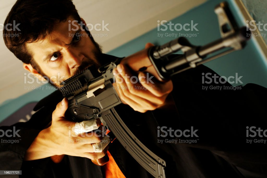 Angry Man Holding Semi-Automatic Rifle stock photo