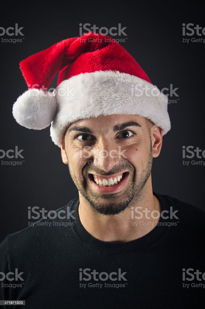 Angry man in Santa Hat royalty-free stock photo