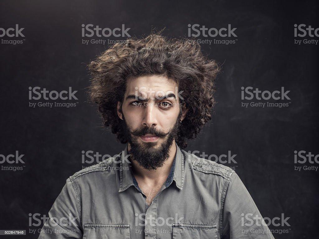 Angry man looking at camera stock photo