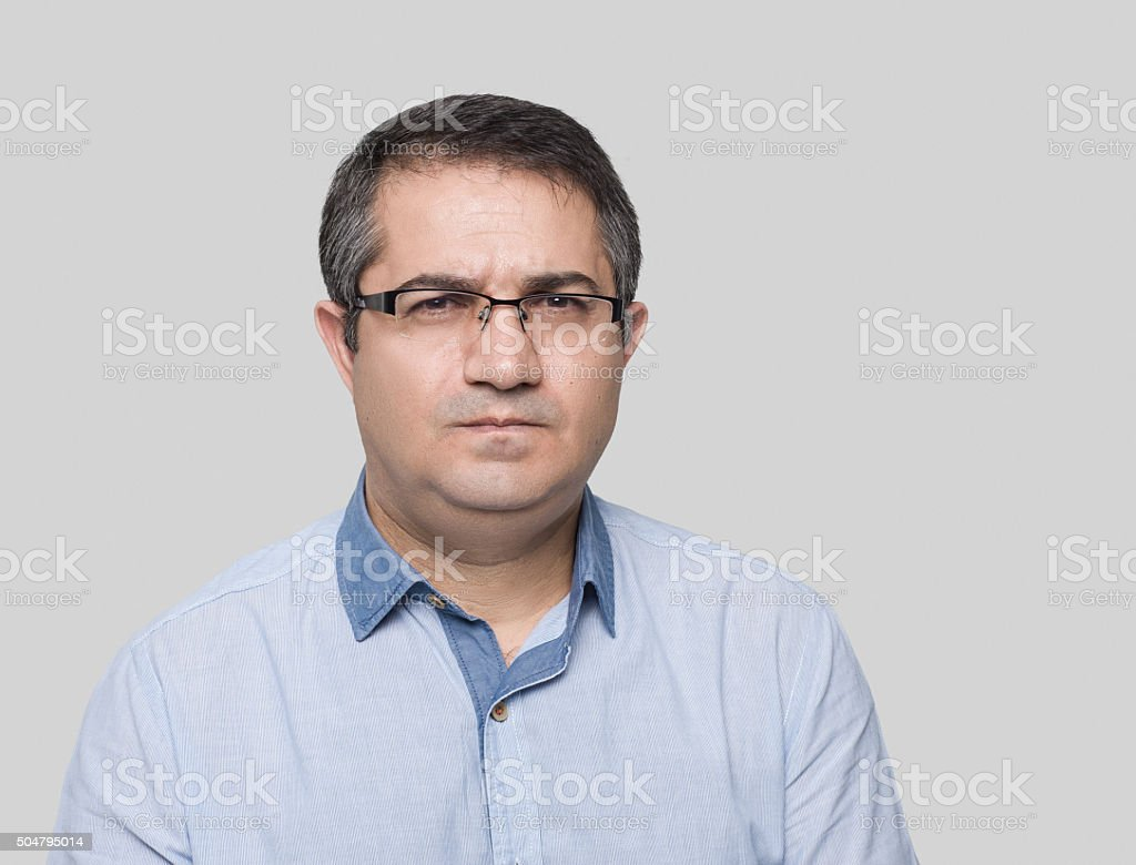 Angry man looking at camera stock photo