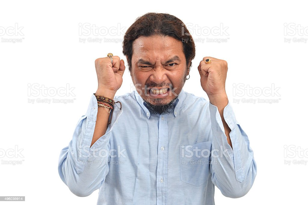 Angry man on a white background stock photo