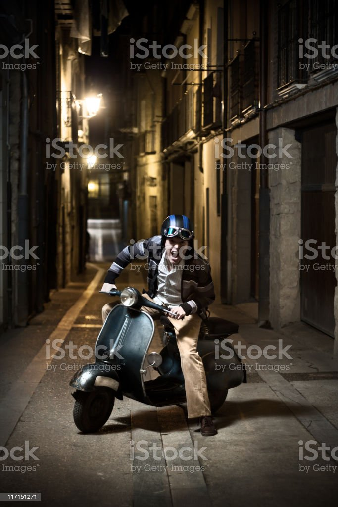 Angry man on Retro Scooter. royalty-free stock photo