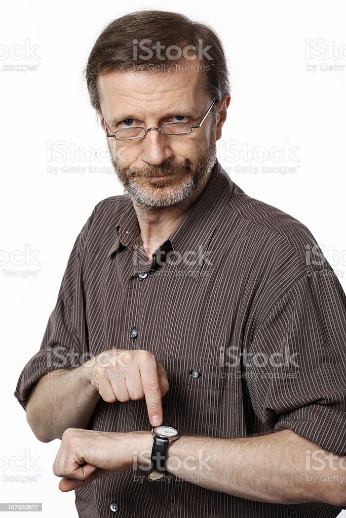 Angry man pointing his wristwatch royalty-free stock photo
