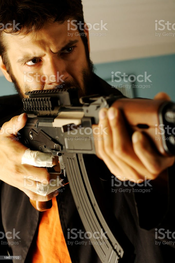 Angry Man Pointing Semi-Automatic Rifle royalty-free stock photo