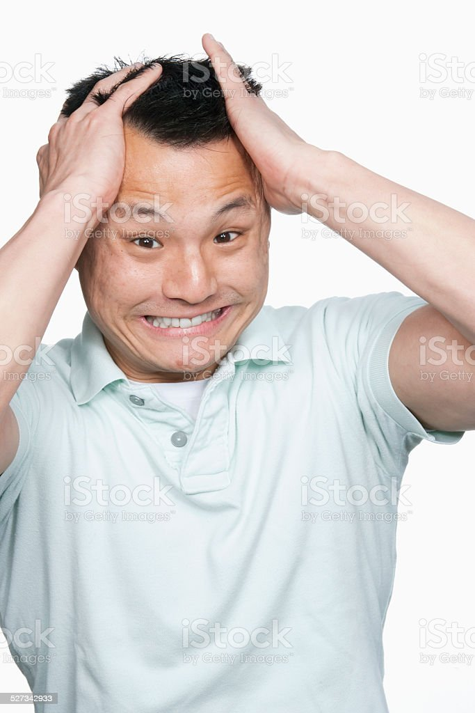 Angry man pulling his hair stock photo