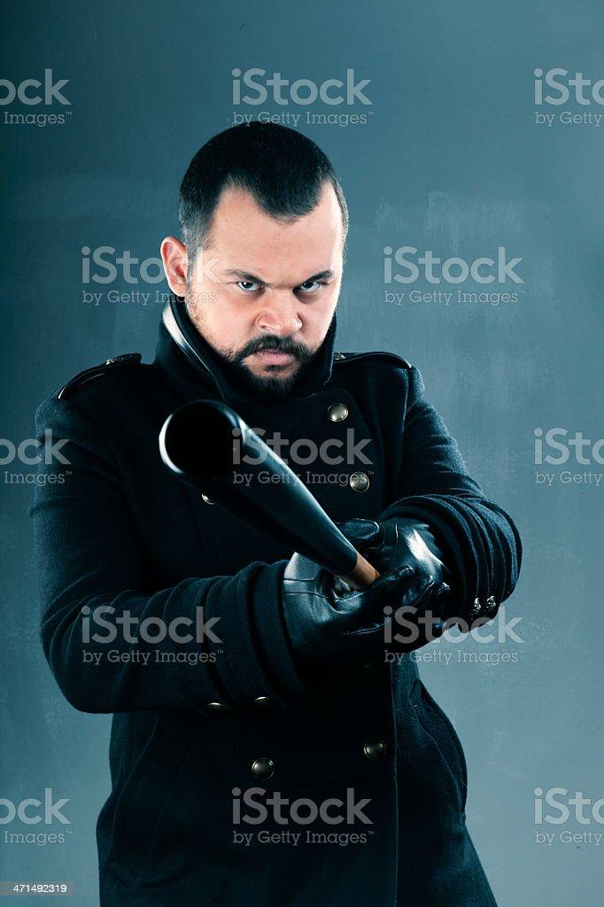 Angry man showing baseball bat royalty-free stock photo