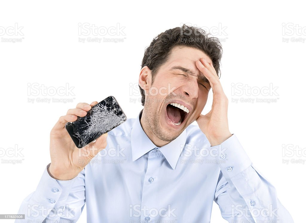 Angry man showing broken smartphone stock photo