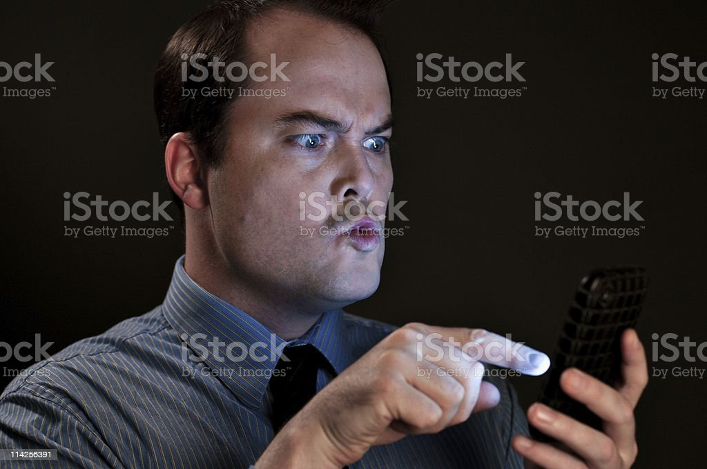 Angry Man Texting stock photo