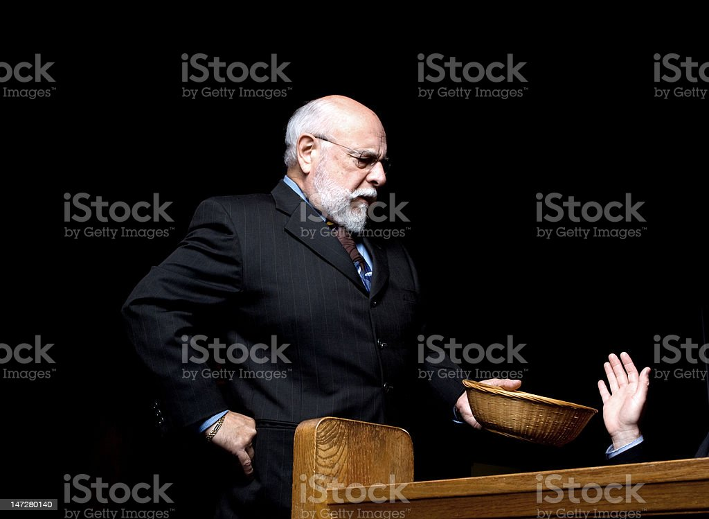 Angry Man Usher Turned Away Hand Church Offering Basket stock photo