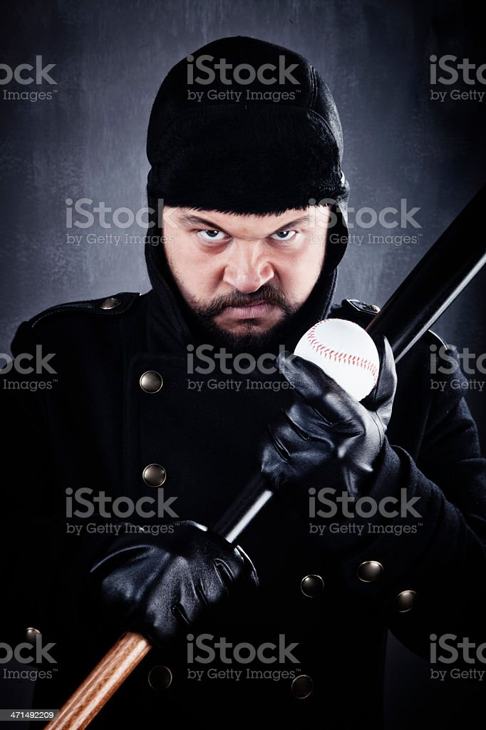 Angry man with baseball bat and ball royalty-free stock photo