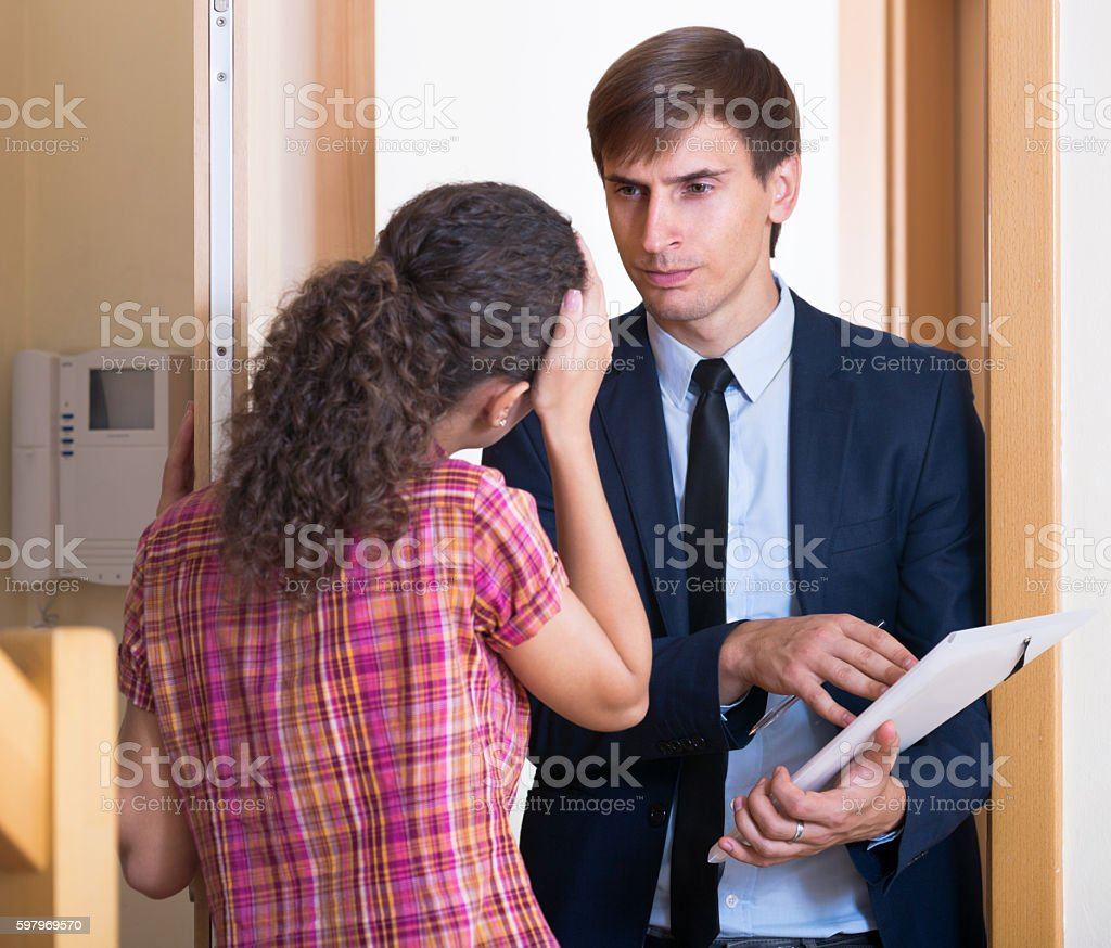 Angry man with documents meeting  girl stock photo