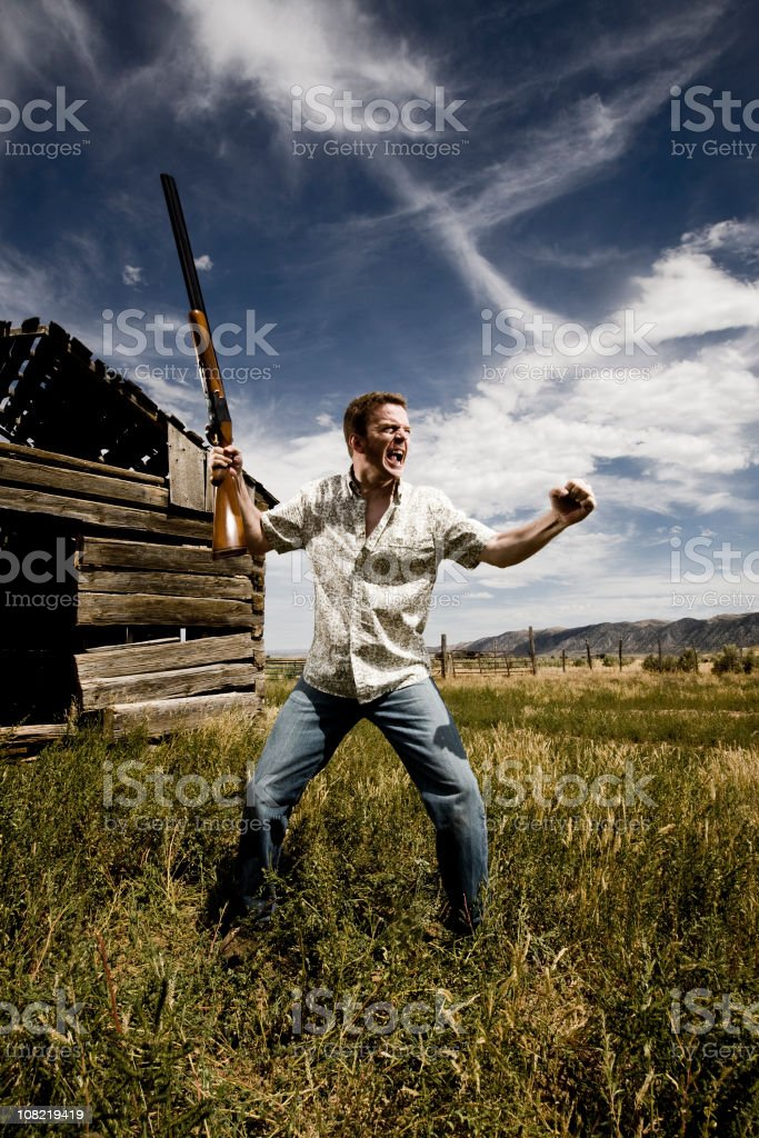 Angry Man With Gun royalty-free stock photo