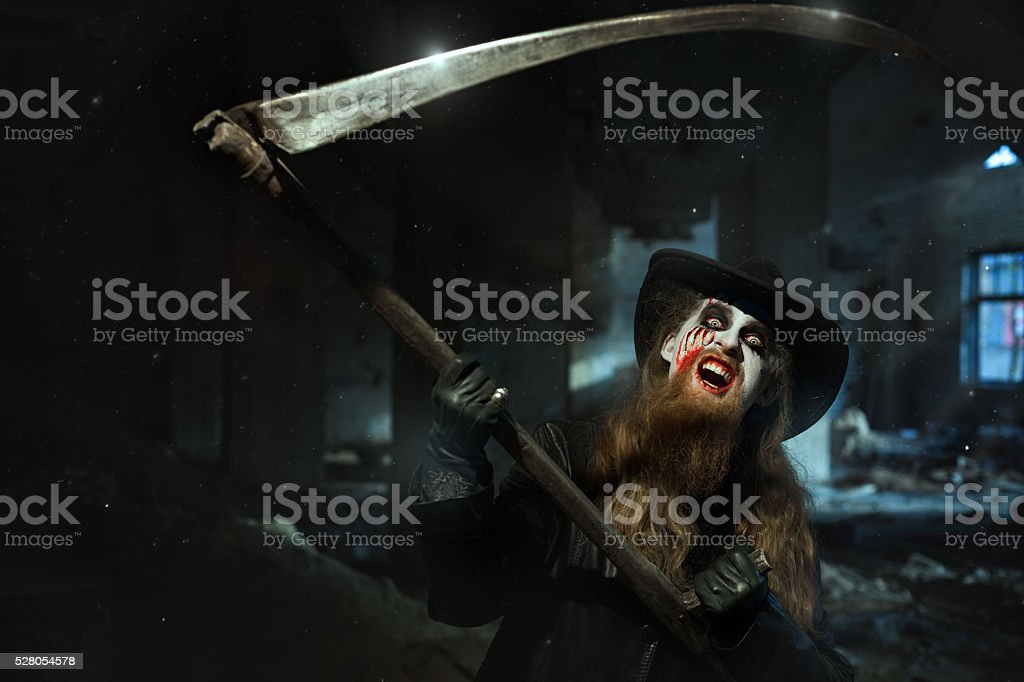 Angry man with the scythe. stock photo