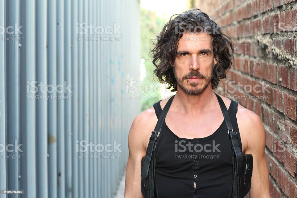 Angry man's portrait in cinematic setting stock photo