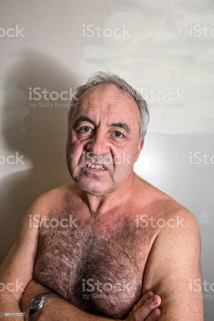Angry mature man  portrait close-up stock photo