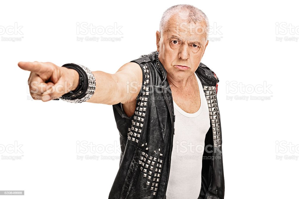 Angry mature punk pointing with his hand stock photo