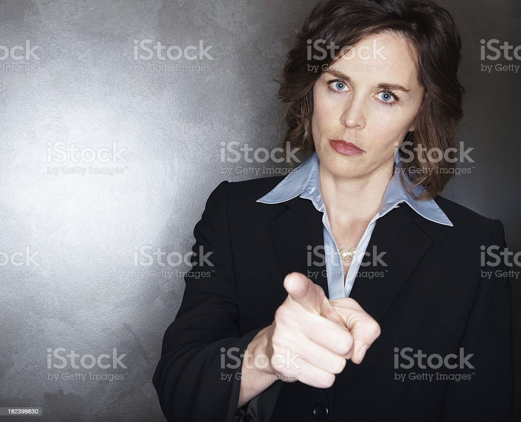 Angry mid adult businesswoman pointing at you royalty-free stock photo
