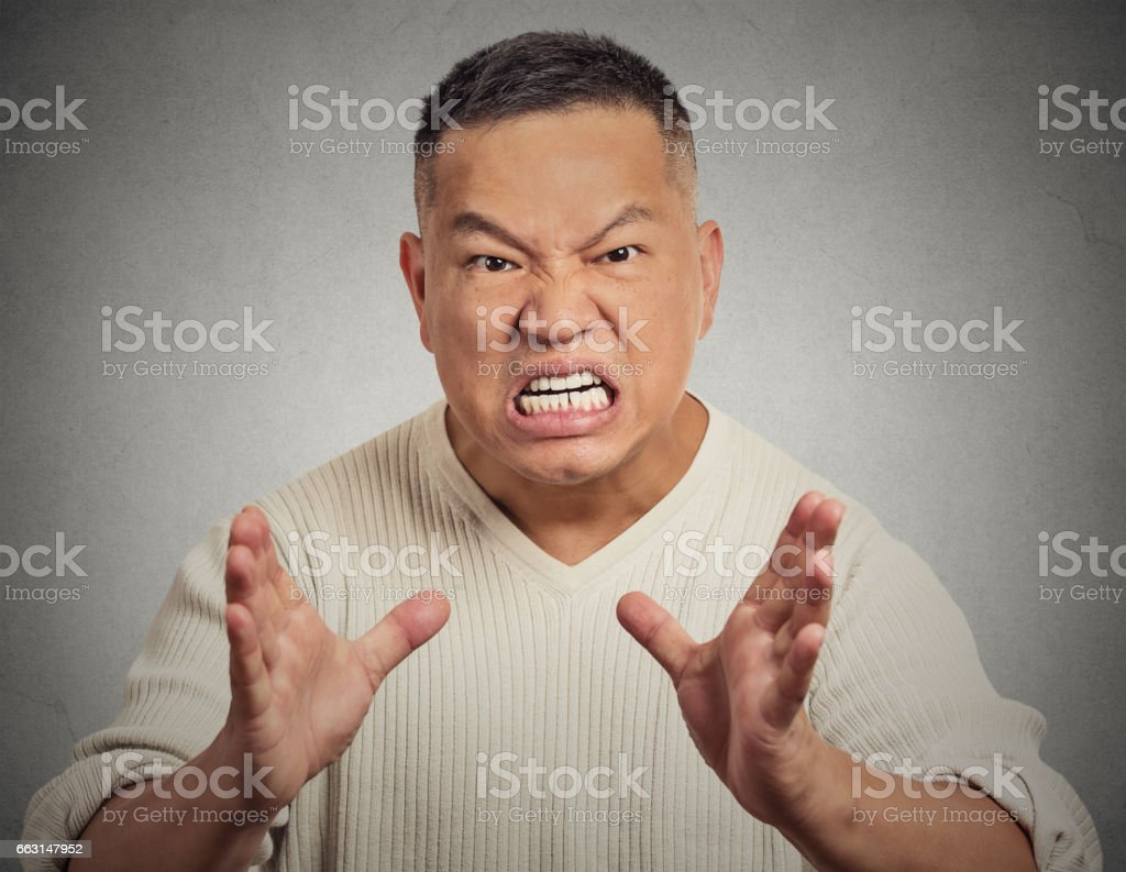 angry middle aged man with open mouth aggressive screaming stock photo