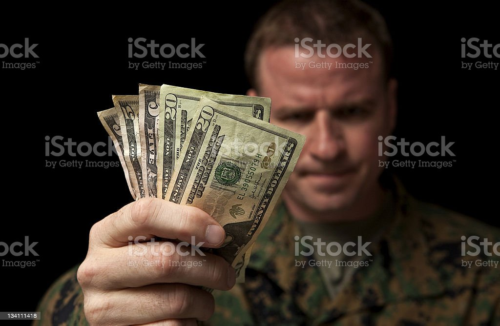 Angry Military Man Hands Over Money stock photo
