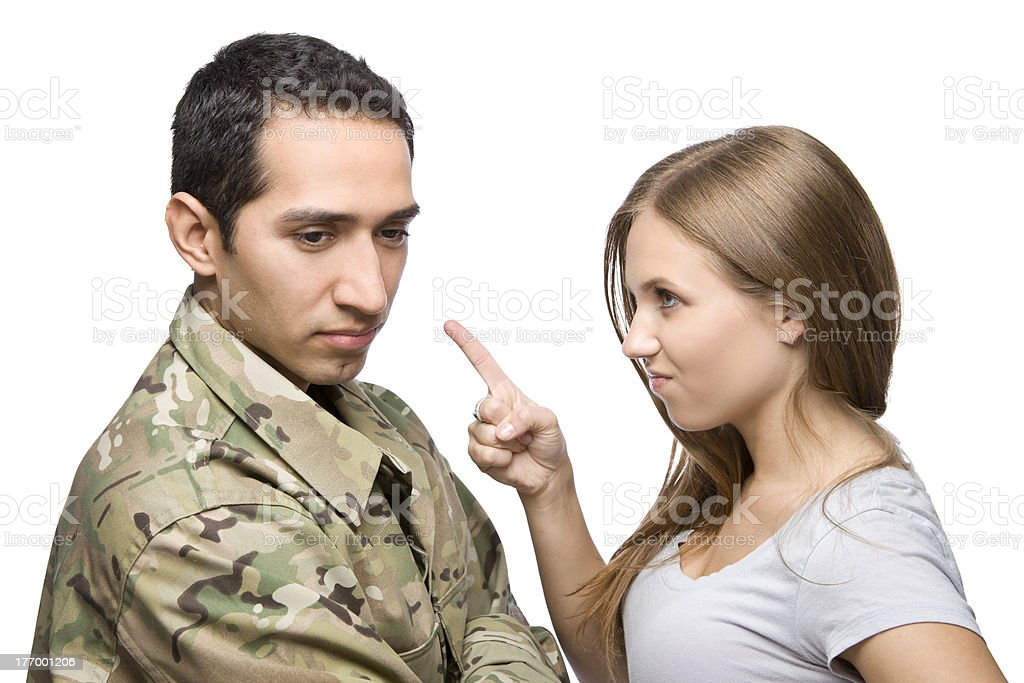 Angry Military Wife Points at Serviceman stock photo