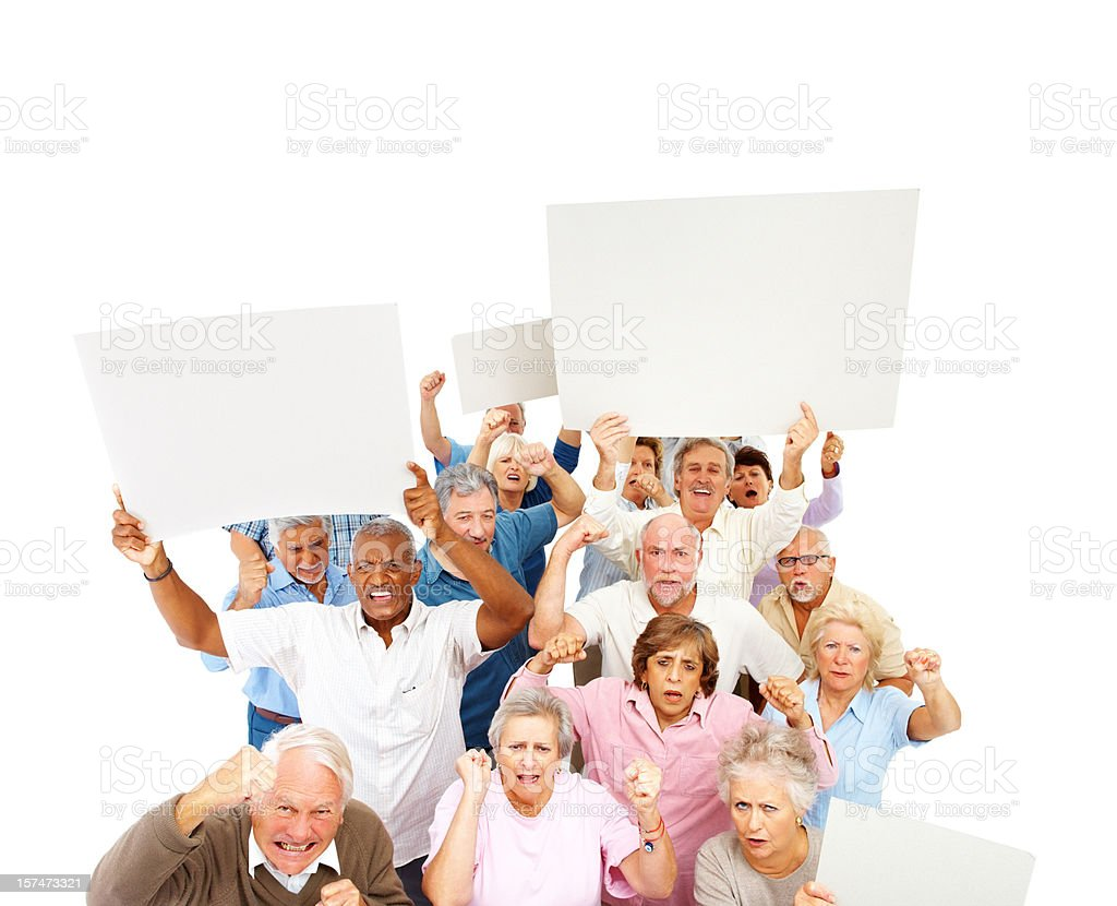 Angry mob of old people with signs royalty-free stock photo
