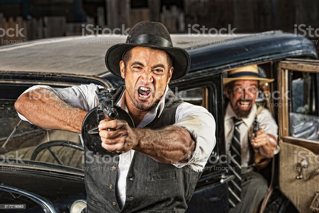 Angry Mobsters Shooting Gun stock photo