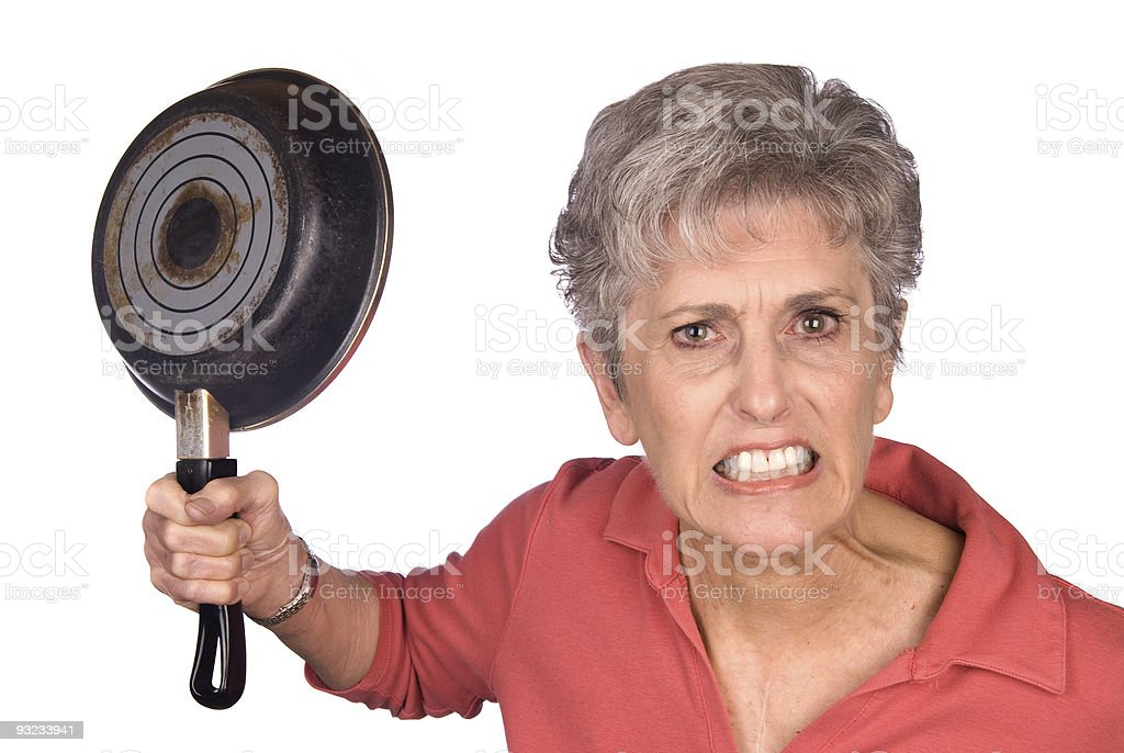 Angry mother and frying pan stock photo