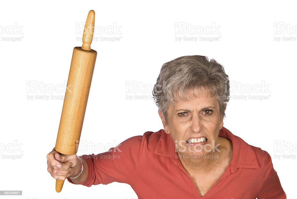 Angry mother and rolling pin stock photo