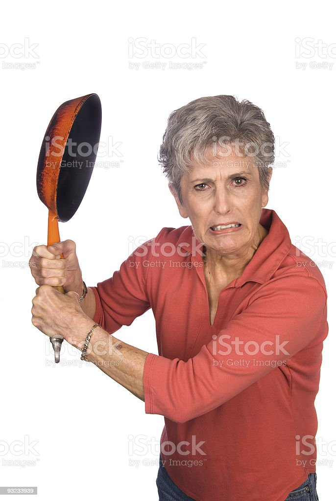Angry mother swinging a frying pan royalty-free stock photo