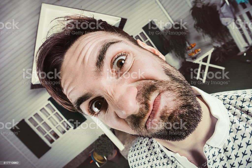 Angry neighbor, comic face stock photo