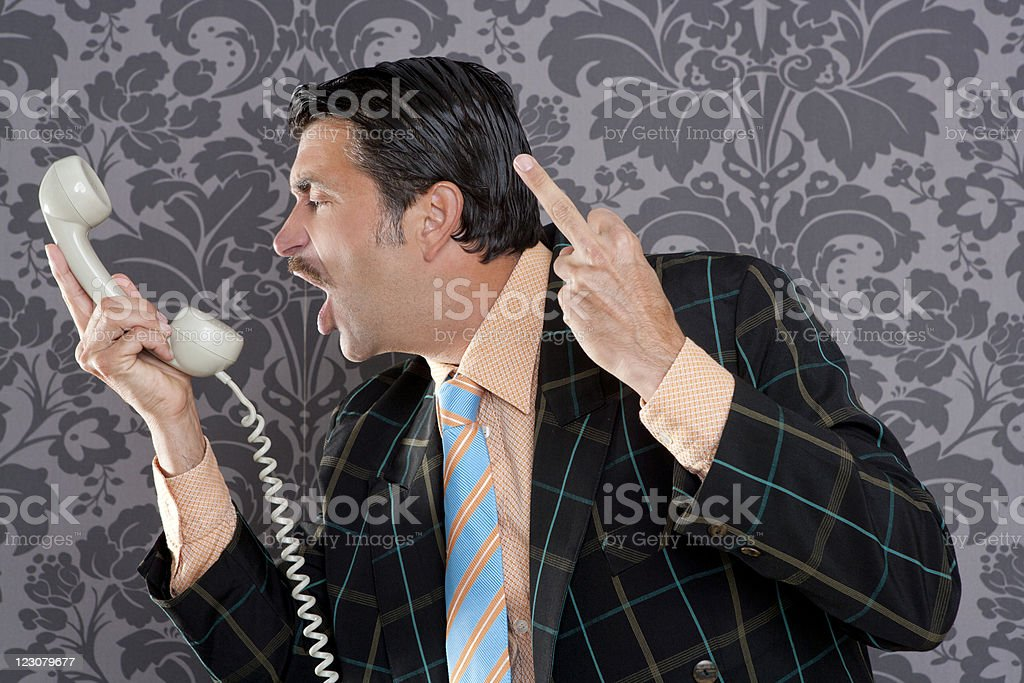 Angry nerd businessman retro telephone call shouting royalty-free stock photo