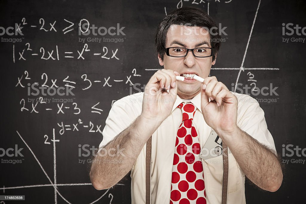 Angry nerd teacher in front of the blackboard royalty-free stock photo
