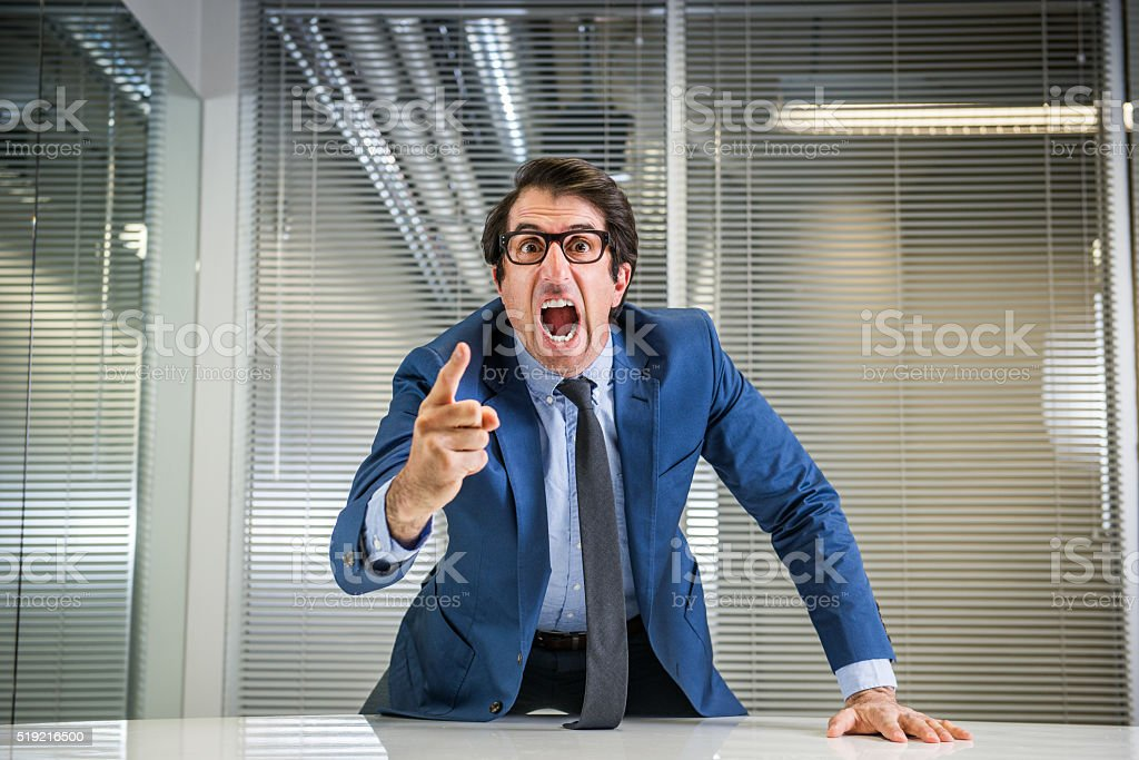 Angry Nerdy Boss Yelling stock photo