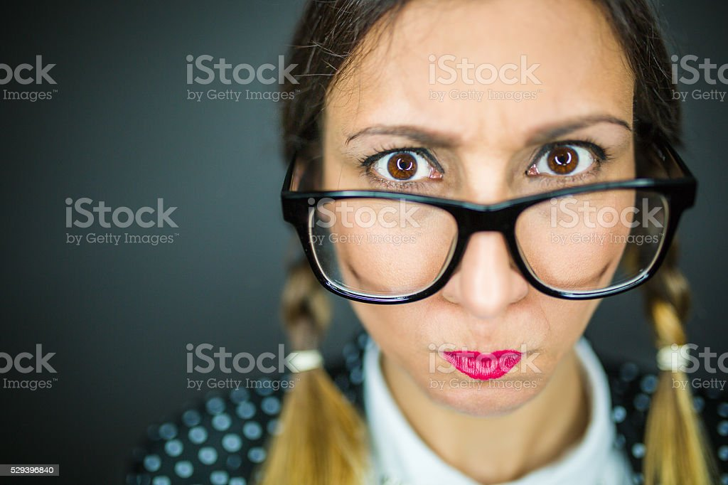 Angry nerdy girl stock photo
