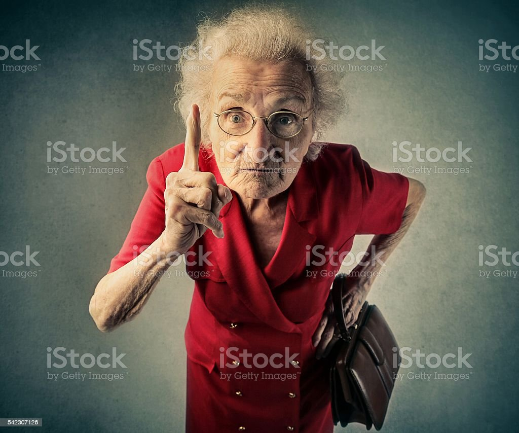 Angry old lady stock photo