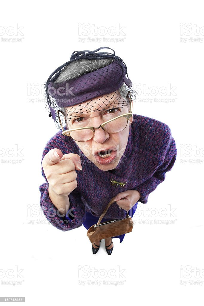 Angry old lady with eyeglasses pointing finger stock photo