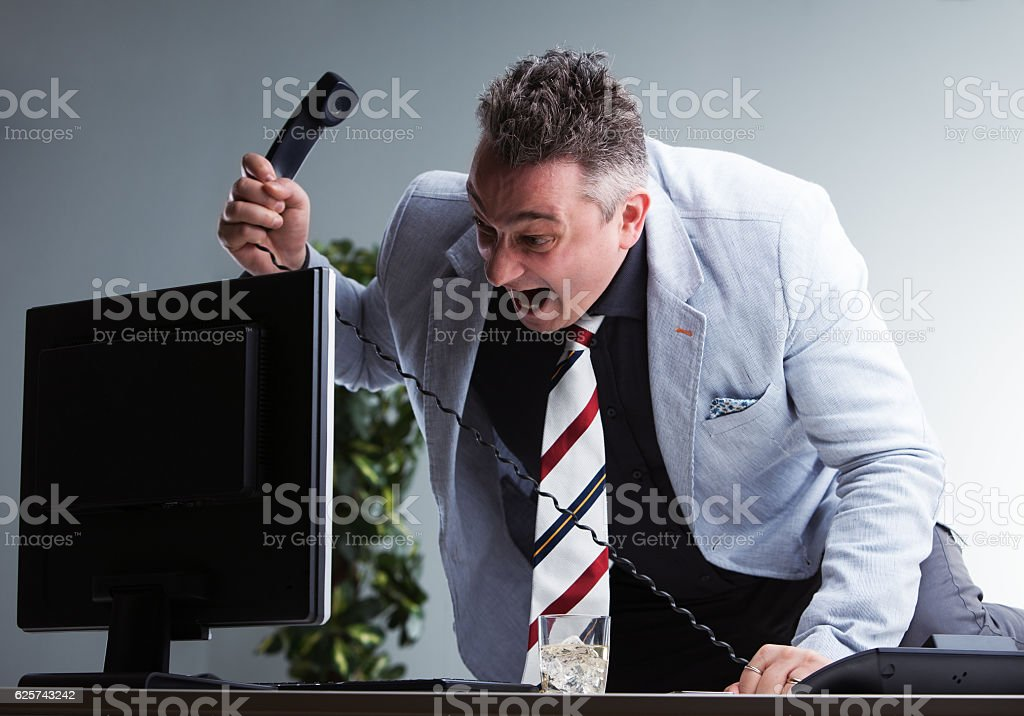 angry plump manager destroying his pc stock photo