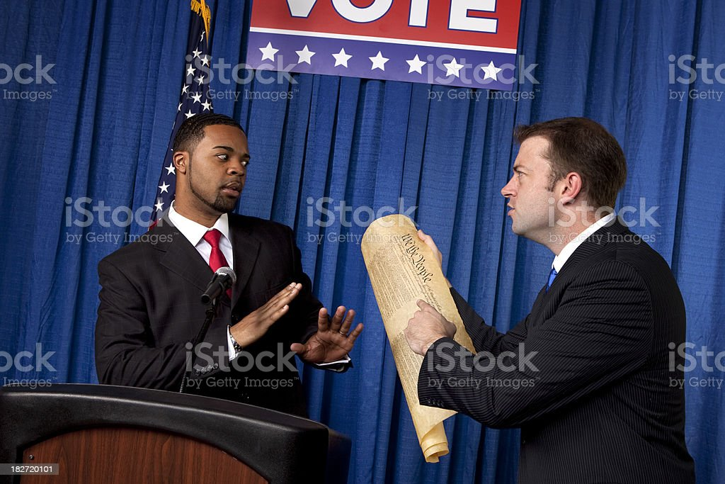 Angry politician pointing to Bill of Rights royalty-free stock photo