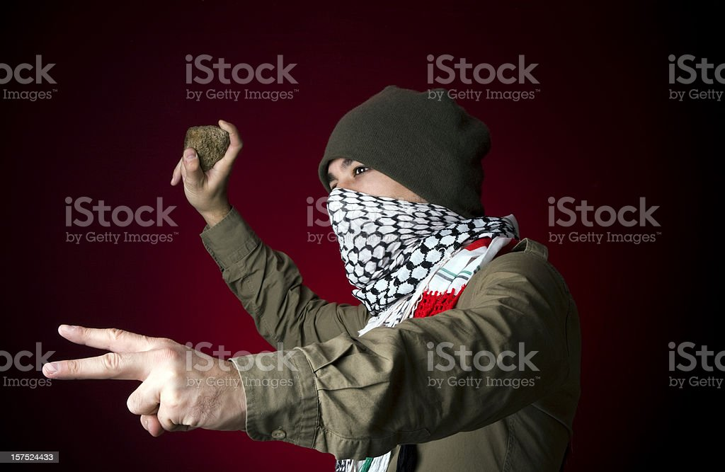 Angry protestor throwing stone royalty-free stock photo