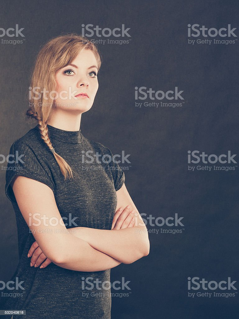 Angry resentful young blonde woman. stock photo