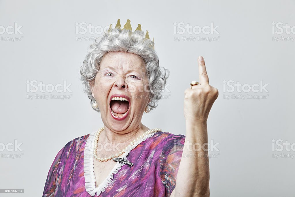 angry retro queen senior woman misbehaving stock photo
