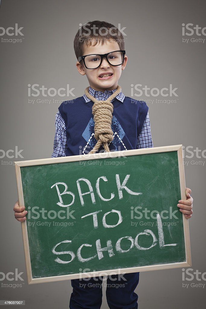Angry school boy stock photo