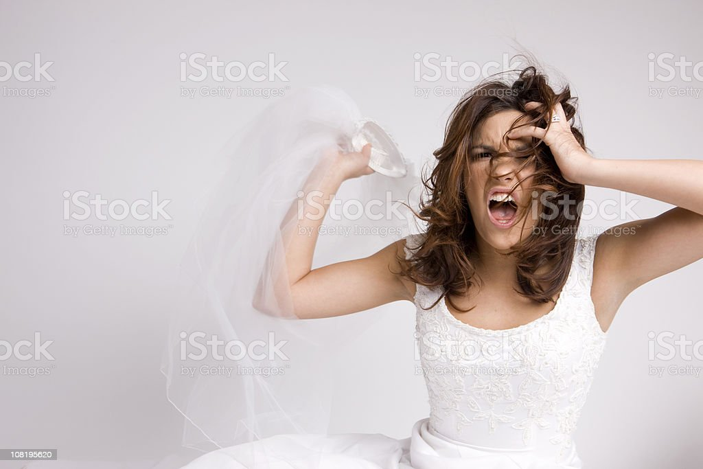 Angry Screaming Bride Throwing Veil stock photo