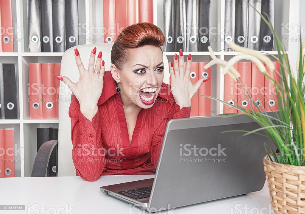Angry screaming business woman in office stock photo