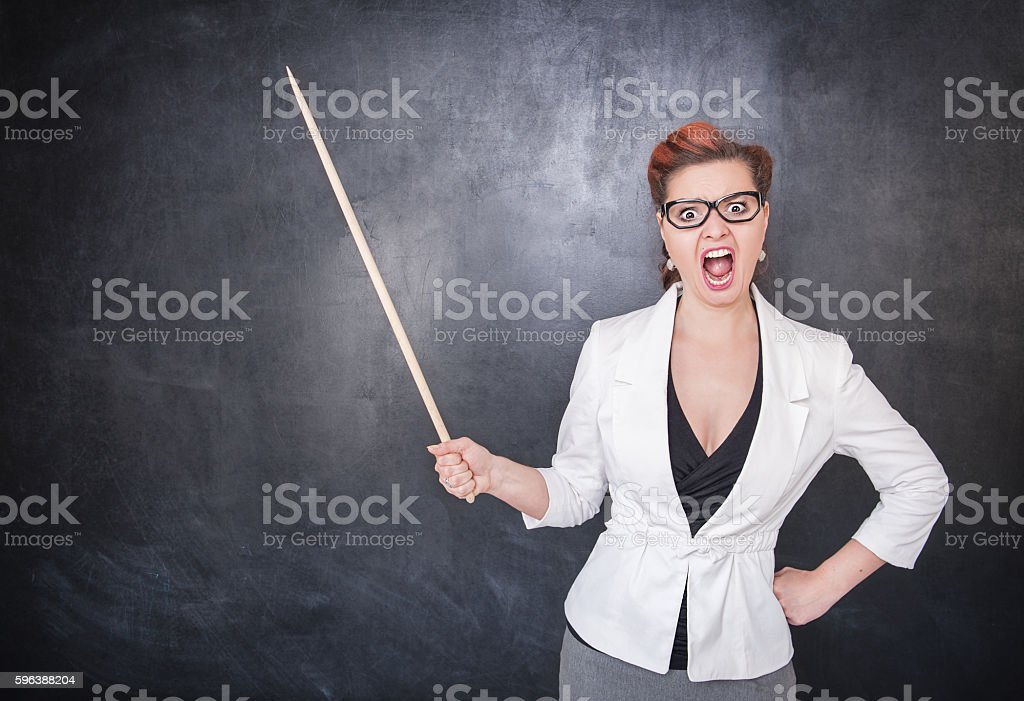 Angry screaming teacher with pointer stock photo