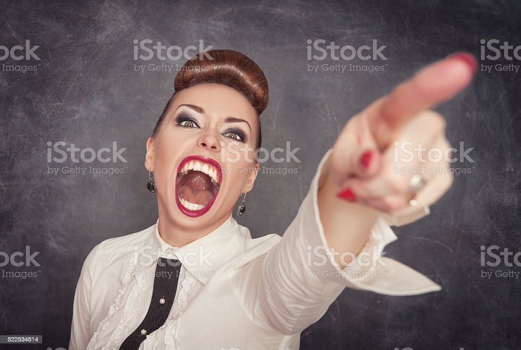 Angry screaming woman pointing out stock photo