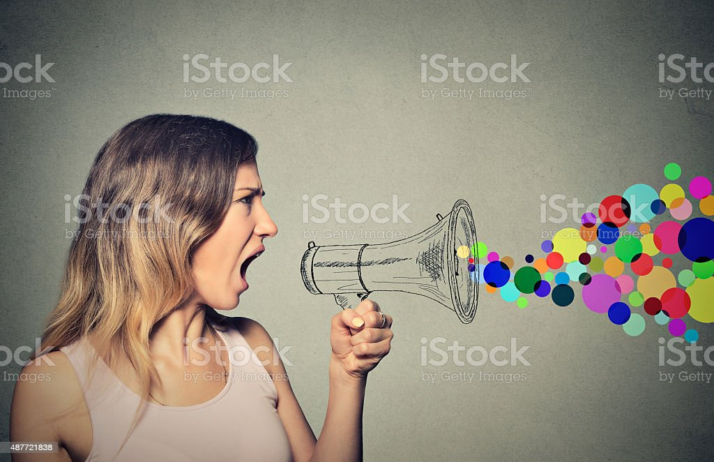 angry screaming young woman holding megaphone stock photo