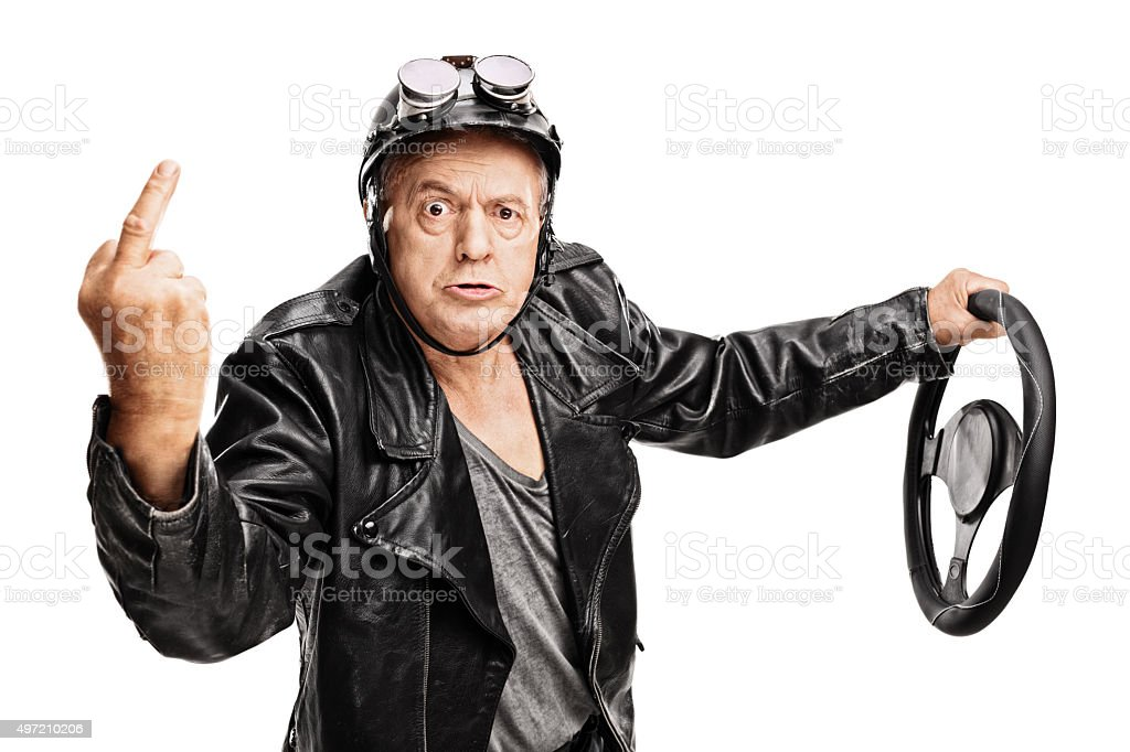 Angry senior driver showing a middle finger stock photo