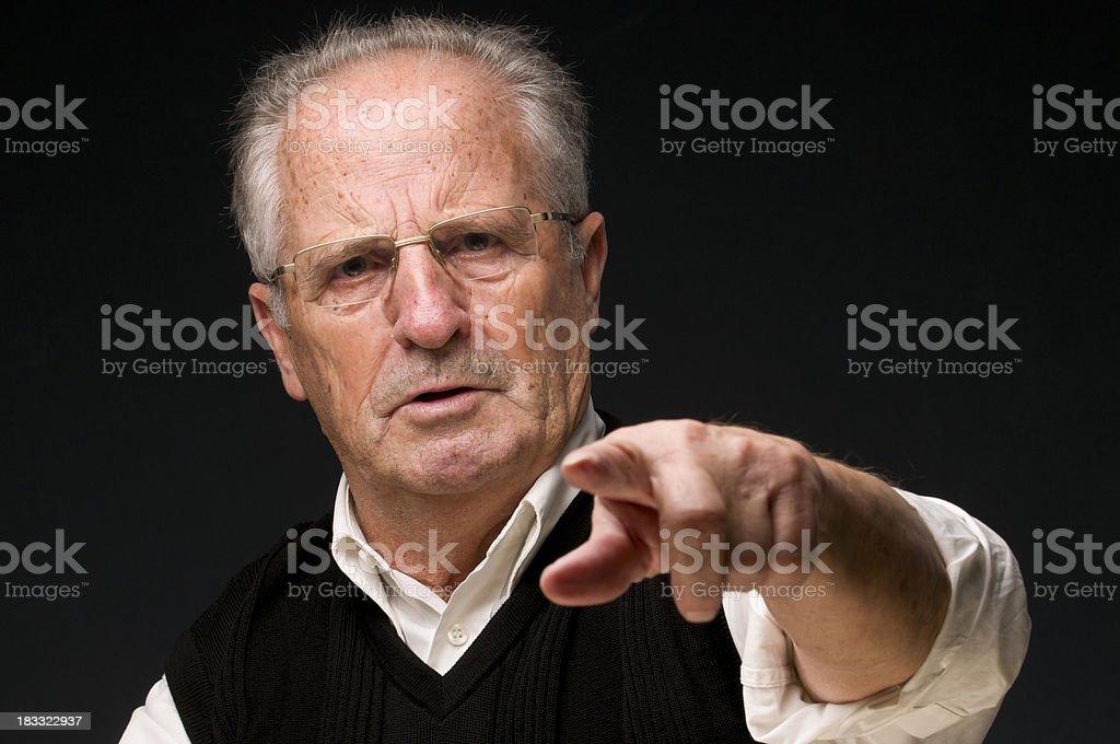 angry senior man pointing at camera royalty-free stock photo